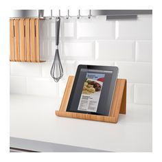 IKEA - RIMFORSA, Tablet stand, You can choose to put the stand on your countertop, or to hang it on the wall for more space when cooking. The stand is stable enough for both books and tablets. Made from a durable material to endure everyday use. At Home Furniture Store, Modern Home Furniture, Ikea Furniture, Ikea Rimforsa, Cookbook Holder, Ikea Us, Apartment Essentials, Tablet Stand, Kitchen Collection