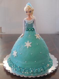 Frozen Elsa cake , doll from Target, dress is iced in buttercream with fondant accents