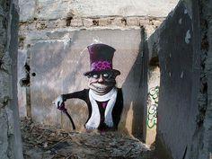 a new kind of mad hatter by mrzer found at http://www.smashingmagazine.com/2008/09/14/tribute-to-graffiti-50-beautiful-graffiti-artworks/