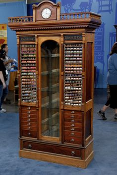 I was drooling over this tonight!  It's an antique spool (thread) display cabinet.  Photo from Antiques Roadshow Facebook page