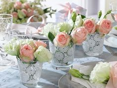 White and pink roses in a glas, romance at the table