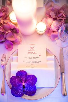 Wedding menu with a purple orchid | One and Only Paris Photography | Brides.com