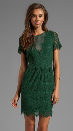 This emerald color is beautiful. I also love the lace!