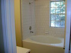Bathroom. Elegant Bathtub Shower Combo Design Idea. Simple Modern Bathtub Shower Combo Design Idea Featuring White Oval Bathtub And White Brick Shower Wall And Polished Chrome Single Lever Handle Head Shower. Bathtub Shower Combo
