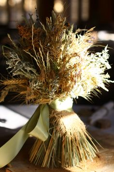 Rustic fall wedding centerpiece from foraged local weeds and grasses.