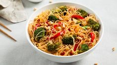 Rice Noodle Bowl with Broccoli and Bell Peppers. Rice noodles give a simple stir-fry a homey feel.