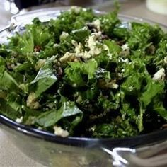 Kale, quinoa, currants, pecans, and feta cheese are tossed in a basic vinaigrette in this salad recipe.