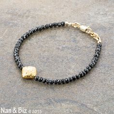 This elegant black spinel bracelet frames a gorgeous and authentic gold Bali bead made of vermeil (sterling silver plated with 24K gold). The