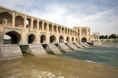 Khaju Bridge, Isfahan, Iran.  Considered to be one of the finest pieces of Persian architecture, not only is the Khaju Bridge both a bridge and a dam, but it's also served as a building where public meetings used to be held.