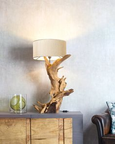 PEAK | The beauty of the root that makes up its base, its natural and asymmetrical shapes, the tortuous lines of the wood, make Peak a unique and exclusive piece of furniture. Much more than a lamp.  #madeinitaly #design #artigiani #interiordesign #artisans #italian #interiordetails #homedesign #homestlye #wood #artists #interiordecor