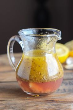 With perfect hint of lemon, garlic, and spices, this Greek Vinaigrette will make you want to eat more salad   littlebroken.com @littlebroken