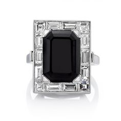 4.67ct Onyx with 2.37ctw Baguette and Square cut diamond surround set in a handcrafted platinum mounting. A classic and sleek Art Deco design.