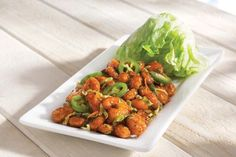Crispy Shrimp Lettuce Wraps with crispy shrimp tossed in soy-ginger sauce topped with jalapenos and served with fresh lettuce cups