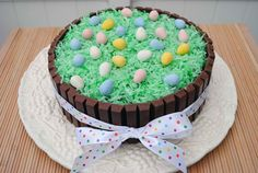 Easter Kit Kat Cake    Ingredients:  Your favorite cake  Icing  22 (.49 oz. size) Kit Kat bars  Coconut   Green food coloring   Cadbury Mini Eggs   Ribbon    Fun for the kids to make.... http://media-cache2.pinterest.com/upload/153474299771631511_RGrEtGjC_f.jpg karenakadimples food party ideas