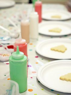 Icing in condiment bottles for kids cookie decorating.