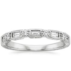 Vintage inspired ring features sparkling diamond baguettes alternating with round diamonds and surrounded by delicate milgrain. ==