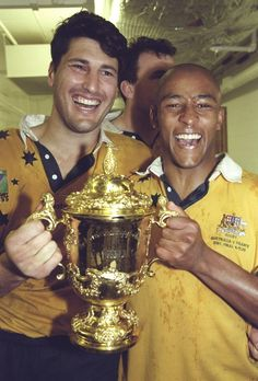 John Eales + George Gregan after winning the 1999 RWC against France.