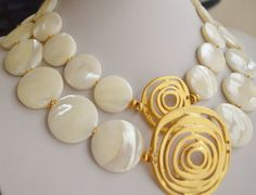 Mother of pearl with gold plated pendant necklace by Lalyca,