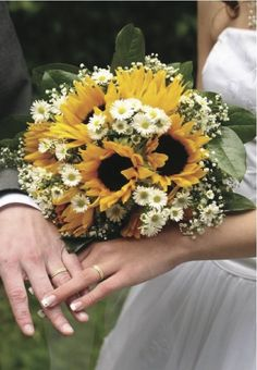 sunflower boquets with red | Need some inspiration for your wedding bouquet? How bout sunflowers ...