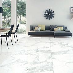 A modern light lounge featuring Porcel-Thin Statuario white large marble effect porcelain floor tiles Slate Effect Tiles, Outdoor Sectional Sofa, Large Floor Tiles, Interior, Tiles, Sectional Couch, Faux Marble, Porcelain Tile, Marble Tiles