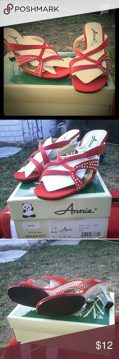 NIB Red sandals with bling These were bought for me and I've never worn them.  Not my style.  They're red satin material with rhinestones. Come in box with original packaging annie Shoes Sandals