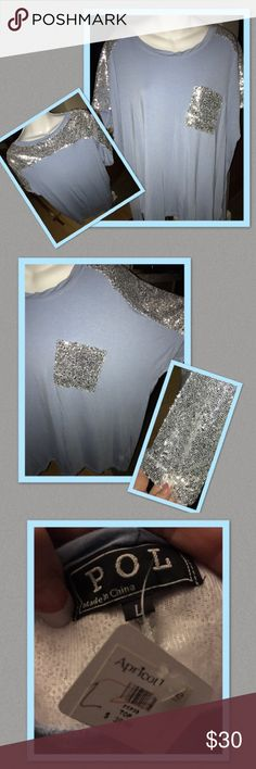 Boutique Top A beautiful brand new with the tags still women's boutique Top in a size Large it's a light blue color with silver sequenced shoulder, shoulder blades and the front pocket also!! It's from the Apricot Lane boutique and it's made by the brand PoL... it's a cotton polyester and spandex blend and it's got a slight hi low detail it's in excellent condition from a smoke and pet free house Pol  Tops