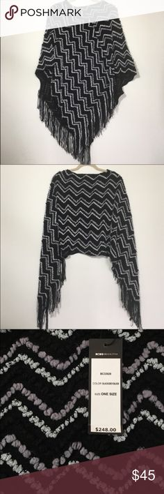 NWT BCBG MaxAzria poncho NWT black poncho with grey and silver knit details. The grey has a soft purple hint to it. 100% acrylic. One size fits all. 🌸automatically save when you bundle, or make me an offer through the offer button!🌸 BCBGMaxAzria Sweaters Shrugs & Ponchos