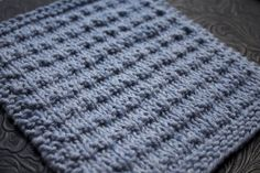 """The latest in my so-easy-you-can-knit-with-swarming-kids dish/washcloth series. If you can knit and purl, you can knit this hanging upside down from the monkey bars. The name . . . I have friends who speak Castilian Spanish and I love the way they pronounce some of their """"s"""" sounds. LOVE IT. I could listen to them …"""