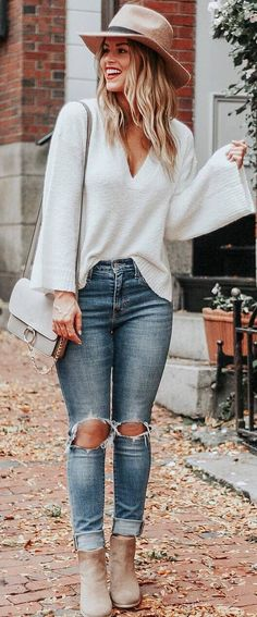 #fall #outfits white sweater ripped jeans beige boots and hat