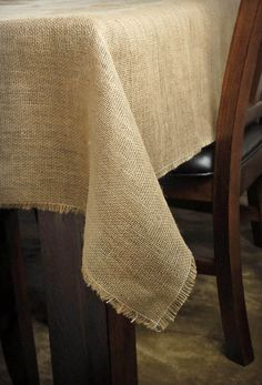 Use the Burlap Square Tablecloth to add rustic accents to your party tables. Whether for an outdoor or indoor occasion, this natural covering brings warmth and simple sophistication to your tables. This tablecloth measures in height and in wi Burlap Tablecloth, Burlap Fabric, Square Tablecloths, Tablecloth Ideas, Wedding Tablecloths, Jute, Save On Crafts, Rustic Wedding Centerpieces, Dining Room