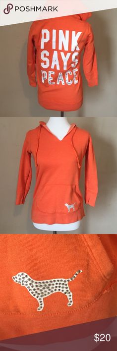 """VS Pink rhinestone hoodie Cute orange hood. Little piling under armpit area from normal wear. A few rhinestones missing on the """"peace"""" letters on the back. Barely noticeable. Reflected in price. Otherwise in great condition. Smoke free home. PINK Victoria's Secret Tops Sweatshirts & Hoodies"""