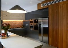 Kyle and Kara's kitchen. Love the brick splash back! And the timber work is gorgeous.