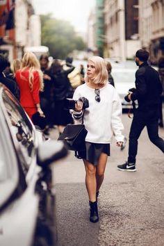 30 ways to wear a black leather skirt - oversized sweatshirt + pointy toe ankle boots // Ramihanna