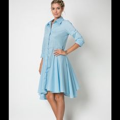 "THE ""JUNE"" SKY BLUE SHIRT DRESS Gorgeous Sky Blue Shirt Dress featuring a button up front. It has an asymmetrical hem & flows lovely around the legs! I call it the ""June"" because I think it's a modern twist on something June Cleaver would wear. Very retro! Sizes S, M, L. Cotton/Spandex. No trades. Dresses"