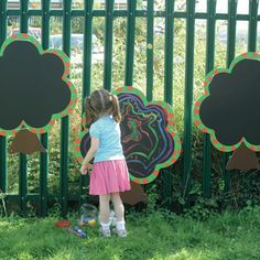 Outdoor chalkboard on fence - use actual tree cross sections and paint with chalkboard paint. (It's also easy to make your own chalkboard paint in any color.)