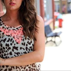 Leopard and Coral Blouse ~ Super cute sheer blouse with Coral details ~ straight fit, suggested for smaller bust ~Bought for $40 ~ Worn once, Great condition Tops Tank Tops