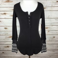 """[Free People] Ski Lodge Knit Cuff Thermal Black XS Classic Free People thermal with button placket. Body hugging fit. Cozy knit cuffs. Perfect for layering!  Color: Black Combo Fabric: Cotton, Polyester, Spandex Size: XS Bust: 14"""" Length: 24"""" Condition: NWT!!!  No Trades! No PayPal! Free People Tops Tees - Long Sleeve"""