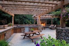 An intriguing backdrop is made at the patio with the spawning of this large wooden pergola. This place is artistically layout with the use of stone made walls, and shelves. This dramatical revamping of the fireplace is raising the beauty of the patio beyond any limits. The use of various plants and trees also looks phenomenal.