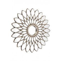Redefine a space with our retro-inspired Starburst Wall Mirror. Featuring a petal style frame finished in antique silver, its bold design is the perfect decorative statement where the emphasis is on glamour, theatre and an Art Decor vibe. Add highlights of silver in artwork, fabric and lighting.