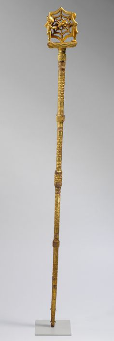 Linguist Staff (Oykeame), 19th–20th century  Ghana; Akan, Asante  Gold foil, wood, nails  H. 61 5/8 in. (156.53 cm)    Magnificent gold-covered staffs like this one are carried by high-ranking officials within the courts of Akan chiefs in an area of West Africa once known as the Gold Coast.