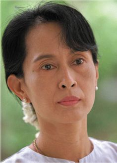 """Released in 2010 from a house arrest that totaled 15 years, Aung San Suu Kyi is an international emblem of power through peace. A political heavyweight and peace activist who speaks of the """"corruptibility of fear,"""" the Nobel Peace Prize winner was held against her will by the military junta ruling Burma, but she refused to abandon her home and fellow activists. In 2011, she was awarded the Wallenberg Medal for her humanitarian efforts."""