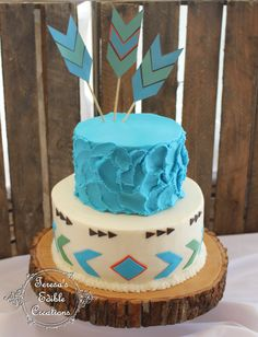 Chevrons and arrows cake Cakes are covered in buttercream, decorates are made from fondant. Arrow tails are paper.