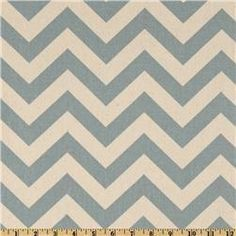 I don't like Chevron when it's too bright. But this one--in a muted blue and cream--works for me. Pair with bright yellow and blue pillows.