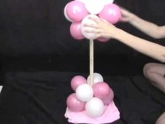 Directions on how to make a mini balloon tree with daises.  This party decoration works well for centerpieces or decorations at wedding receptions.  Party Decoration Ideas