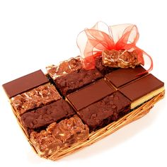 Gourmet Slices Gift Basket (A)  Our delicious chocolate Gourmet Slice yummy cakes. This basket is packed to bursting with a selection of triple chocolate brownies, millionaire shortbread slices and our chocolate biscuit rocky road.  Fabulous handmade cakes using natural ingredients, presented and packed they make the perfect cake gift to send. Chocolate Biscuits, Gifts Delivered, Gift Cake, Flowers Delivered, Rocky Road, Hampers, Delicious Chocolate, Chocolate Brownies, Shortbread