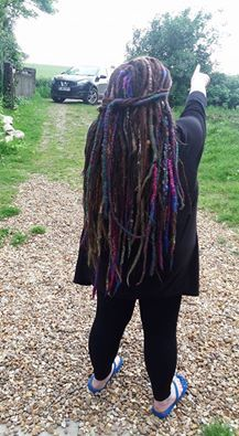 dreads at #blackarrowdreads and accents of wonderful colour by Monarch Dreads. I am the maker of wonder at black arrow dreads.
