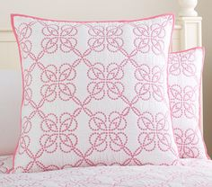 Satin-stitch embroidery creates chains of flowers across the supersoft ground of our whole-cloth quilt. Girls Room Paint, Whole Cloth Quilts, Satin Stitch, Quilt Bedding, Pottery Barn Kids, Embroidery Stitches, Euro, Floral Design, Throw Pillows