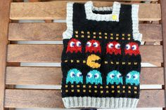 Pac man jumper!  I will have to chart this out for my next knitting project!