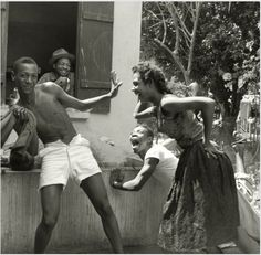 A traveling photographer Denise Colomb took this photo of these Haitian teenagers in the countryside. (1958)