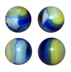 """Akro Agate (Hybrid?) Popeye Patch. This image shows 4 different views of the same marble. The base is translucent, clear glass with ribbons of blue, egg yolk yellow and white. There are some small air bubbles trapped inside the clear section. It measures 41/64"""" (slightly over 5/8""""). etsy.com/shop/CosmicLibrary"""